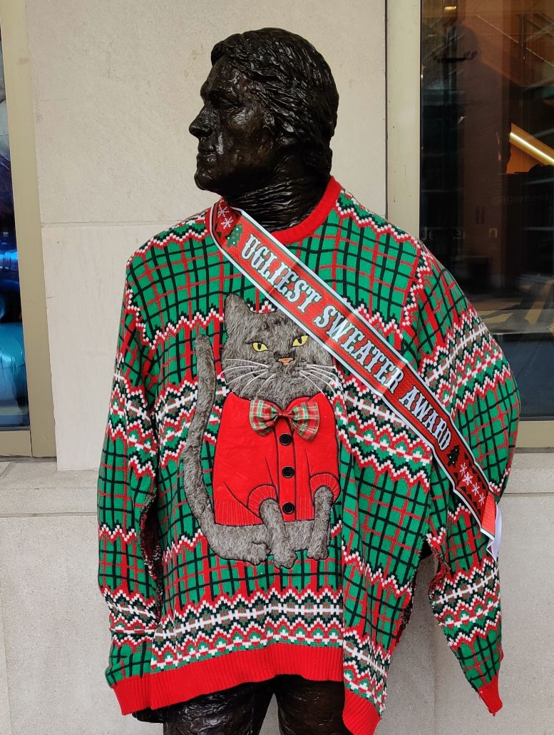 Statue wearing ugly sweater